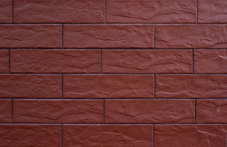 fragment of a wall of brown bricks bonded with cement, full frame Stockfoto