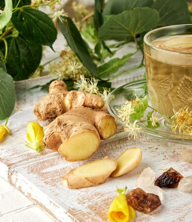fresh ginger and transparent cup with herbal tea, close up Stockfoto
