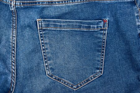 back pocket on blue jeans, full frame, close up Stock Photo