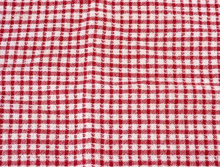 toalla de cocina de algodón rojo-blanco, full frame, patrón de celdas Foto de archivo