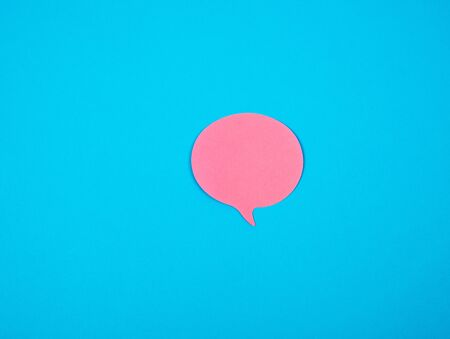 pink sticker in the shape of a cloud on a blue background, copy space