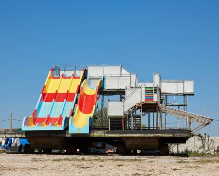 water attraction stands on a sandy coast on a summer day, Ukraine