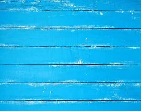 blue old wooden background with cracked paint, parallel boards, full frame