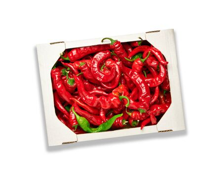 ripe red hot pepper in a white cardboard box isolated on white background, top view