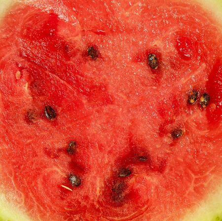 texture of ripe red watermelon with seeds, juicy flesh, full frame