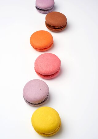 multi-colored baked macaroons from almond flour on a white background, selective focus Stok Fotoğraf