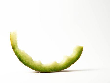 eaten stub of melon on a white background, copy space Stock fotó