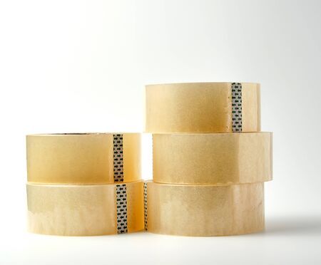 two stacks  of transparent adhesive tape on a white background, close up