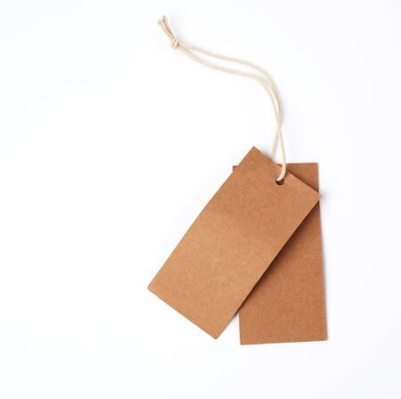 empty rectangular paper brown tag on the rope, white background, close up Stock fotó