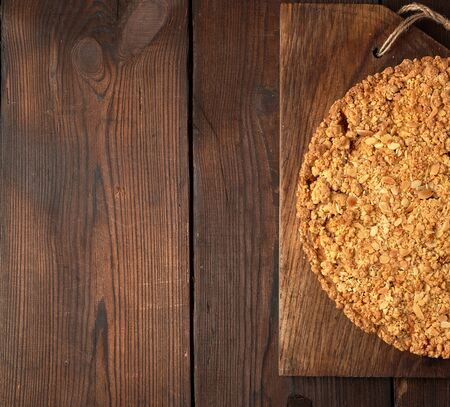 pieces of crumble pie with apples on a brown wooden board, copy space