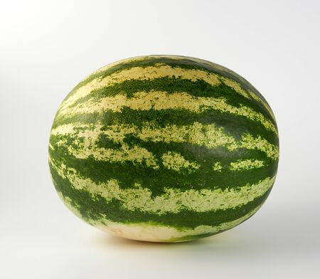 big green striped whole watermelon on a white background, summer berry Stock fotó
