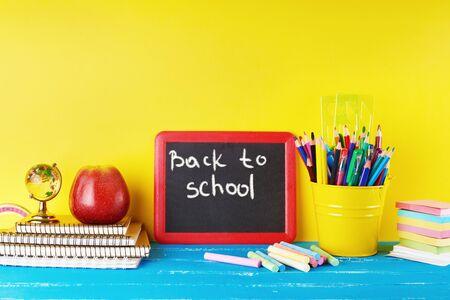 black chalk frame, chalks and school supplies on a blue background, concept back to school 版權商用圖片