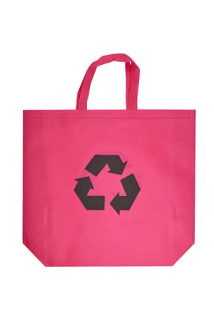 Reusable pink viscose bag isolated on white background, plastic waste reduction concept
