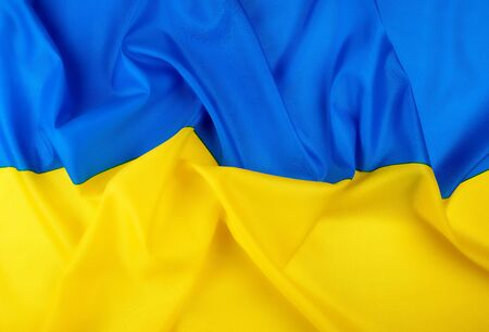 blue-yellow textile silk flag of the state of Ukraine, symbol of independence and the struggle for freedom, full frame