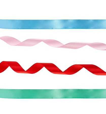 green and blue straight, curled red and pink satin ribbons isolated on white background, festive backdrop