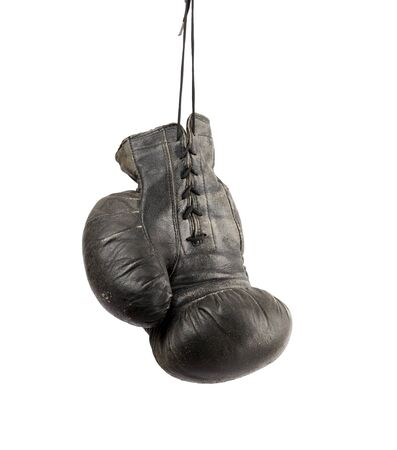 very old black right boxing glove hanging on a cord isolated on white background Stockfoto