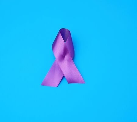 purple ribbon as a symbol of early research and disease control, Alzheimer's disease, cystic fibrosis, lupus, pancreatic cancer, sarcoidosis Stock Photo