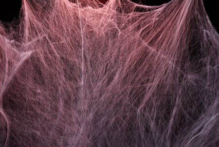 stretched white web with red backlight, background for the holiday Halloween, copy space