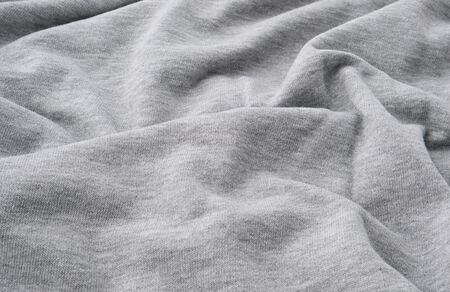 gray cotton stretch fabric for sewing clothes, canvas with waves, close up