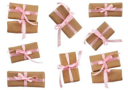 set of rectangular boxes wrapped in brown kraft paper and tied with a pink ribbon, gifts are isolated on a white background, element for a designer Stock fotó - 138368172