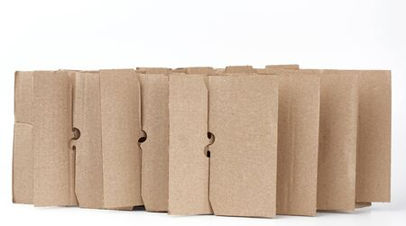 brown cardboard partition for a box, a subject for transporting bottles on a white background