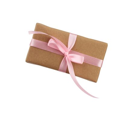 rectangular box wrapped in brown kraft paper and tied with a pink ribbon, gift isolated on a white background, element for a designer Stock fotó - 138368525