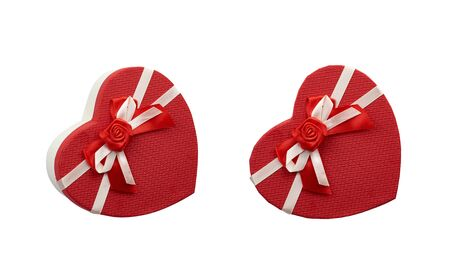 red heart-shaped cardboard box with bow isolated on white background, holiday gift wrapping Foto de archivo - 138468586