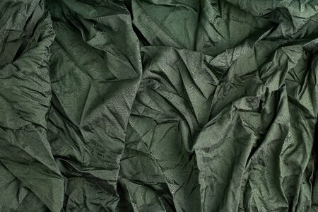 green satin textile fabric, piece of fabric for sewing curtains and things, full frame