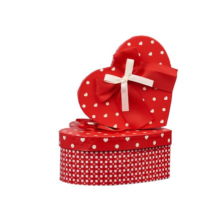 red heart-shaped cardboard box with bow isolated on white background, holiday gift wrapping Stock fotó