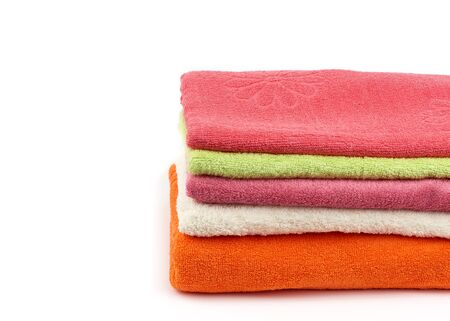 stack of colored cotton terry folded towels on a white background, copy space Banque d'images