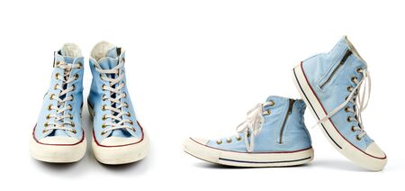 pair of light blue worn textile sneakers with laces and zippers on a white background, side view of shoes and front view, set Stock Photo