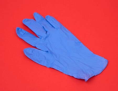 blue medical rubber glove for carrying out procedures and manipulations, subject is isolated on a white background