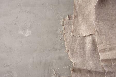 very old gray vintage kitchen towel on gray cement background, top view, copy space Foto de archivo