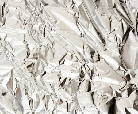 texture of matte crumpled piece of foil, food and objects packaging material, full frame