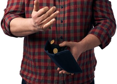 man in a red shirt pours hryvnia coins from a brown leather wallet into his hand, poverty concept
