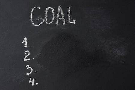 black chalkboard with inscription gosl and list, concept of planning and strategy
