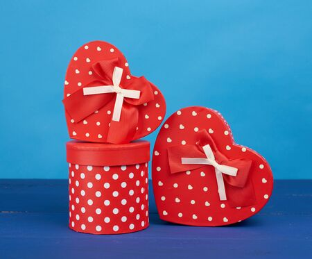 red cardboard boxes with gifts on a blue background, festive backdrop