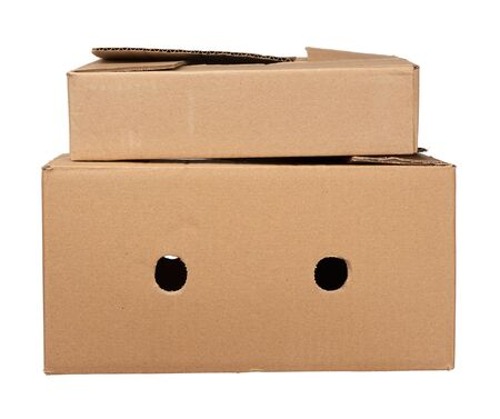 stack of closed cardboard brown paper boxes isolated on white background