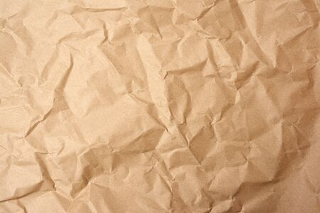 crumpled blank sheet of brown wrapping kraft paper, vintage texture for the designer, full frame Banque d'images