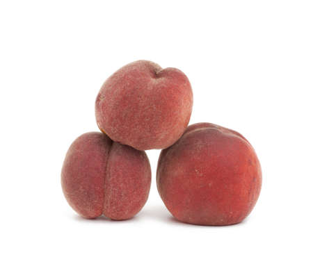 whole ripe red peach isolated on a white background, close up