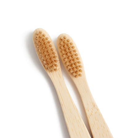 two wooden toothbrushes on a white background, plastic rejection concept, zero waste Archivio Fotografico