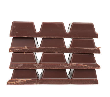 stack of pieces of black chocolate on a white background, delicious dessert and ingredient for cooking, close up