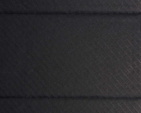 black cardboard texture with folds, full frame, inside of perfume box