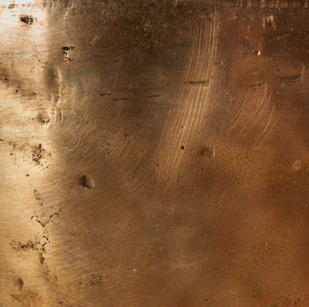 texture of yellow old copper plate with scratches and scuffs, full frame, macro