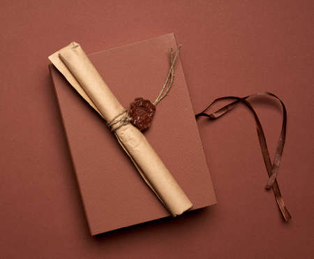 brown paper roll sealed with wax seal, top view, close up 免版税图像