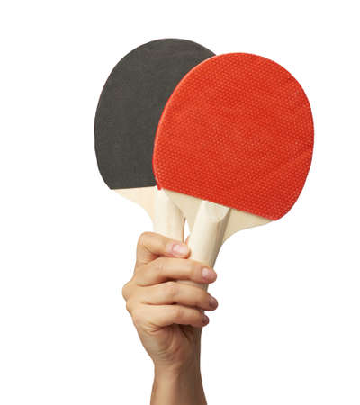 female hand holds two wooden table tennis rackets, white background