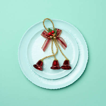green round red ceramic plate, festive table setting for christmas and new year, top view