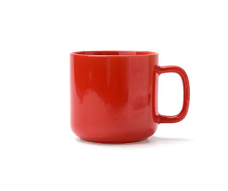 red ceramic mug with handle isolated on white background, close up Фото со стока