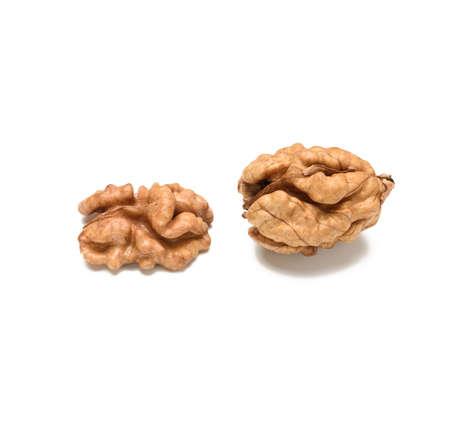 peeled walnut isolated on white background, close-up