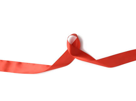 twisted red ribbon isolated on white background, element for designer Фото со стока